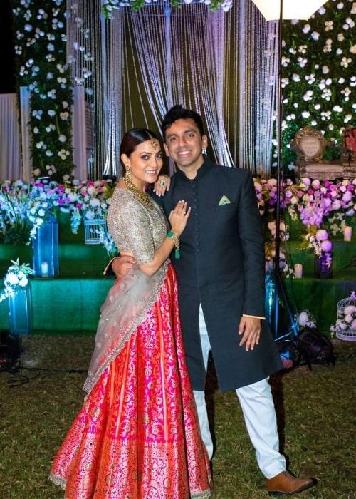 Nisha Agarwal as seen while smiling for a picture alongside husband Karan Valecha