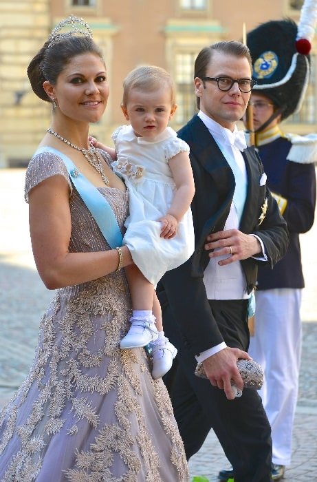 Prince Daniel and Crown Princess Victoria with their daughter on the way to the castle church at the Royal Palace in Stockholm for the wedding between Princess Madeleine and Christopher O'Neill