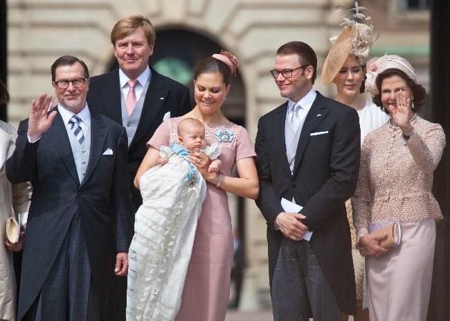 Princess Estelle, Duchess of Östergötland with her parents, grandparents, and godparents after her baptism in Stockholm, Sweden in May 2012