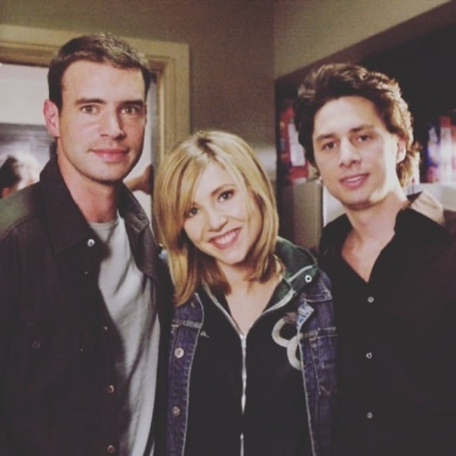 Scott Foley (Left) posing for a picture with Sarah Chalke and Zach Braff