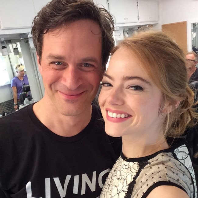 Tom Everett Scott smiling for a picture alongside Emma Stone in September 2015