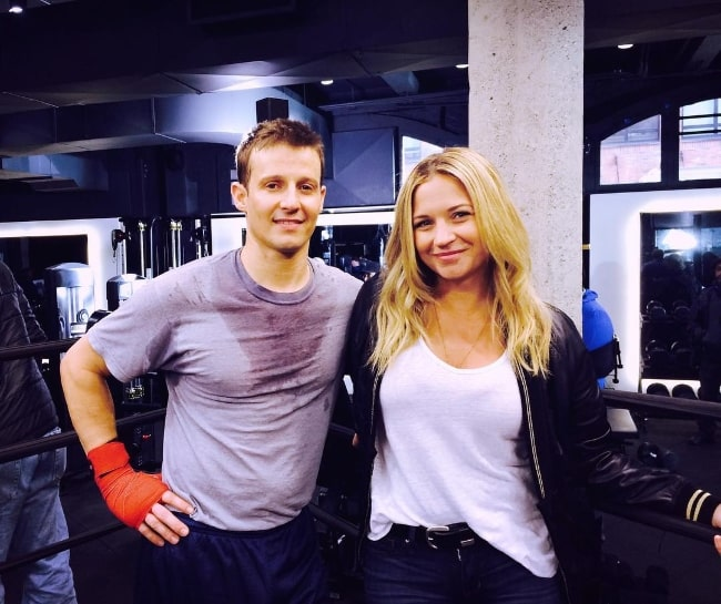 Will Estes and Vanessa Ray posing for a picture during a workout in October 2016