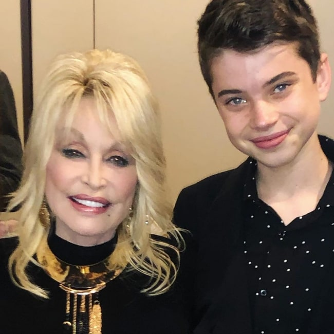Aidan Langford as seen in a picture with singer and songwriter Dolly Parton in November 2019