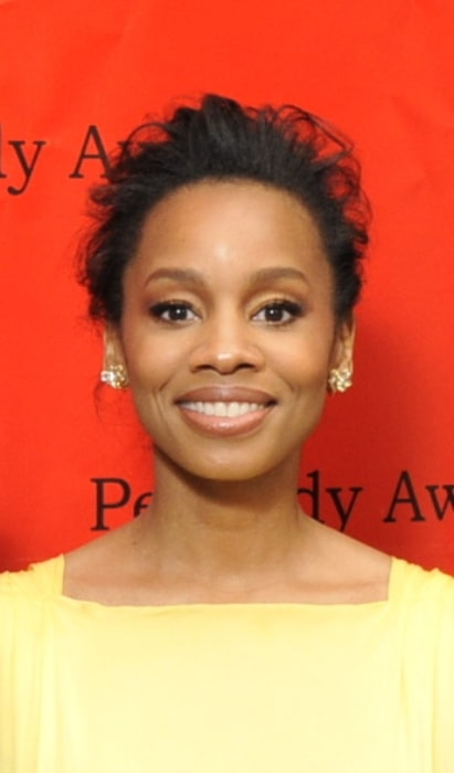Anika Noni Rose smiling for a picture at the 69th Annual Peabody Awards Luncheon at Waldorf Astoria Hotel New York on May 17, 2010