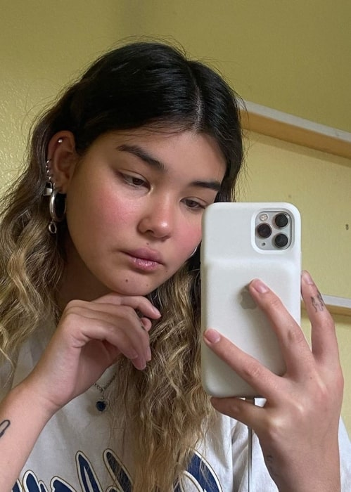 Audrey Mika using her phone after her computer gets over heated making her video freeze