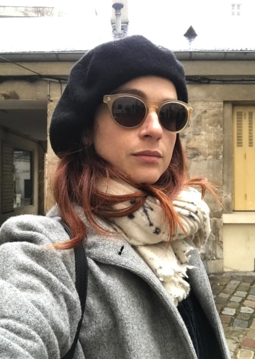 Aya Cash in December 2017 sharing her selfie wearing the beret she bought as a tourist in Paris