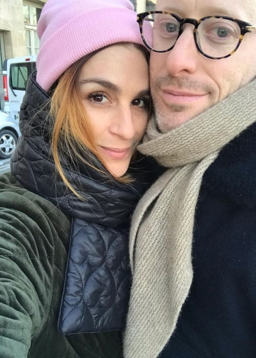 Aya Cash with her husband in the end of December 2019 wishing everyone a happy new year