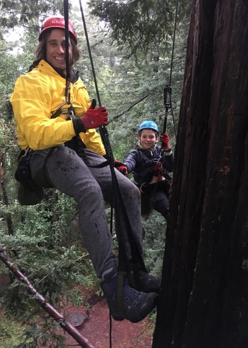 Brad Falchuk climbing to the top of a giant redwood in March 2018