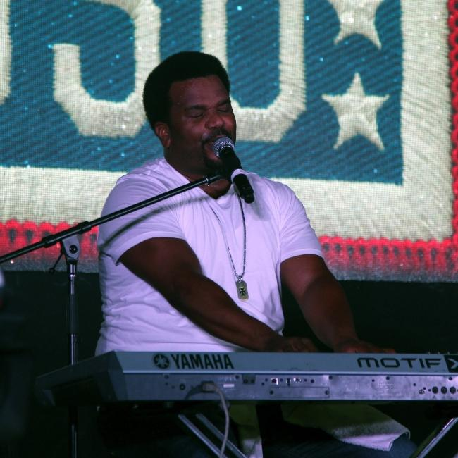 Craig Robinson sings his songs in his stand-up comedy musical act during The Today USO Comedy Tour Show held at Bagram Air Field, Afghanistan on October 1, 2014