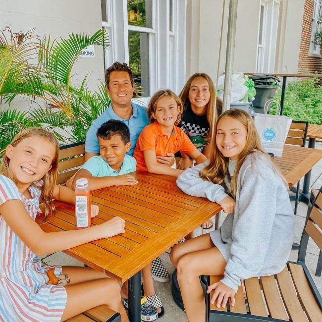 Daniel Rich as seen in a picture with his children Evie Rich, Brinley Rich, Kapri Rich, Sebi Rich, and Hampton Rich at the Meraki Juice Kitchen in June 2020