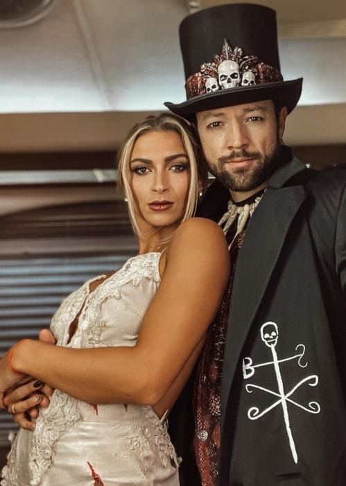 Daniella Karagach in October 2020 with her husband wishing everyone a happy Halloween