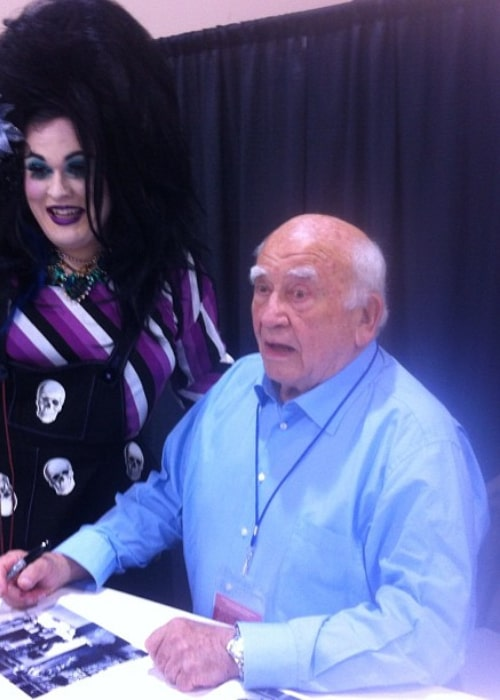 Ed Asner posing with a fan in September 2012