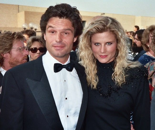Harry Hamlin posing for the camera along with then-wife, Laura Johnson at the 1987 Emmy Awards