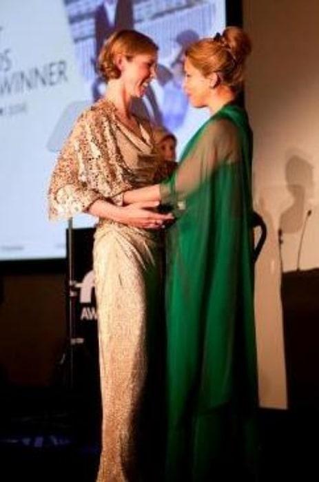 Haya bint Hussein (Right) pictured while congratulating FEI 2012 award winner Courtney King-Dye