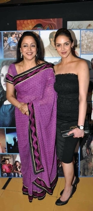 Hema Malini (Left) smiling for a picture alongside her daughter Esha Deol at 'Tell Me O Kkhuda' Trailer Launch in February 2009
