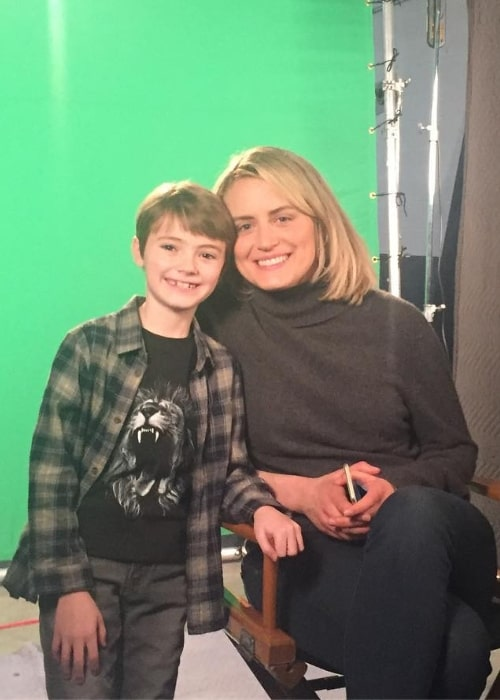 Jackson Robert Scott posing for a picture along with Taylor Schilling in April 2018