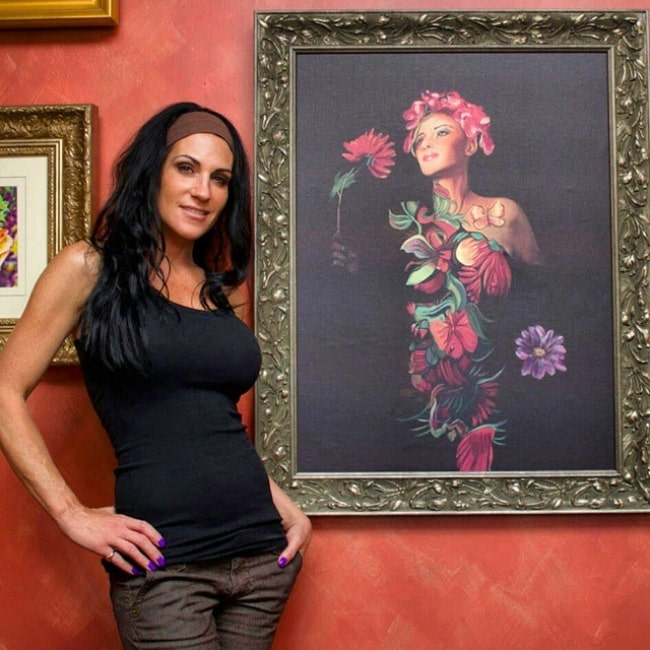 Jen Seidel in May 2015 with one of her fine art paintings of her bodypainted models