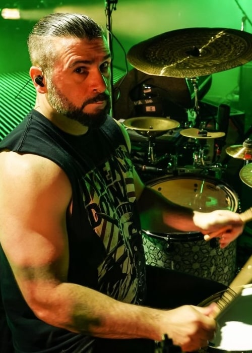 John Dolmayan as seen while playing the drums on stage in January 2018