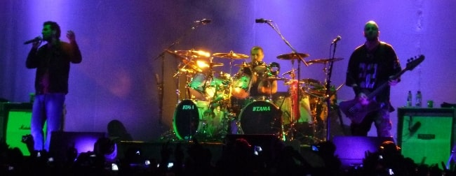 John Dolmayan pictured while drumming with System of a Down in 2011