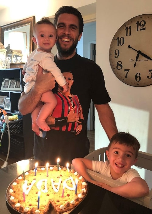 Josh Segarra smiling for a picture alongside his sons in June 2020