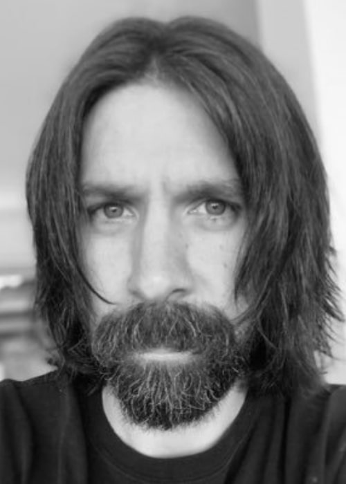 Joshua Gomez as seen in a black and white selfie that was taken in the past