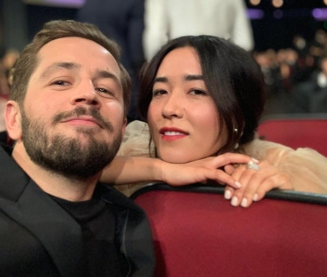Maya Erskine as seen while smiling in a picture alongside Michael Angarano in September 2019