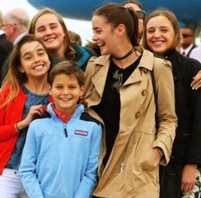 Natalie Biden (In Red) in a picture with her family