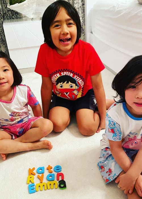 Ryan Kaji with his younger sisters, Emma and Kate, as seen in November 2020