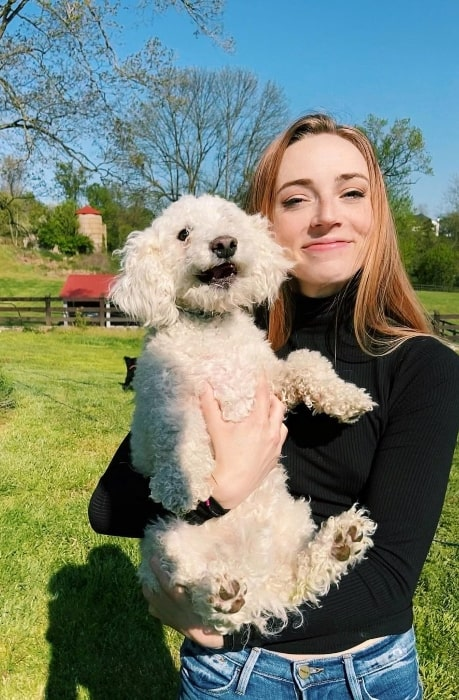 Sarah Mezzanotte as seen while posing for a picture with a dog in May 2020