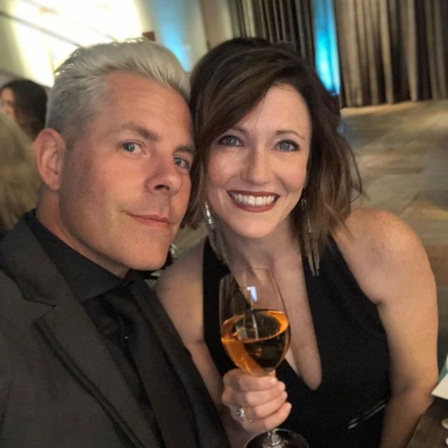 Trevor and his wife posing together on their wedding anniversary in 2019