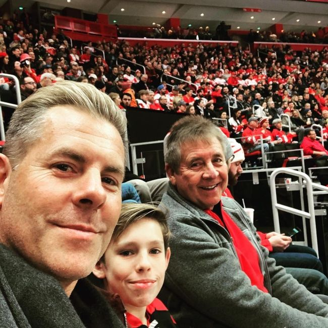 Trevor as seen with his father and son during a Detroit Red Wings hockey match in 2018