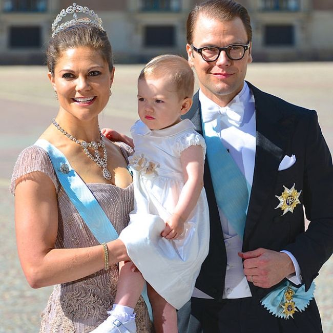 Victoria as seen with Prince Daniel, and Princess Estelle in 2013
