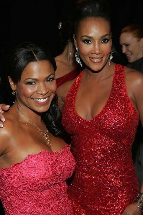 Vivica A. Fox (right) as seen posing with Nia Long at the Heart Truth fashion show in 2009