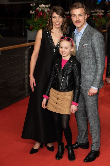A young Helena Zengel posing for the camera along with Nora Fingscheidt and Albrecht Schuch on the red carpet of the Berlinale closing gala 2019
