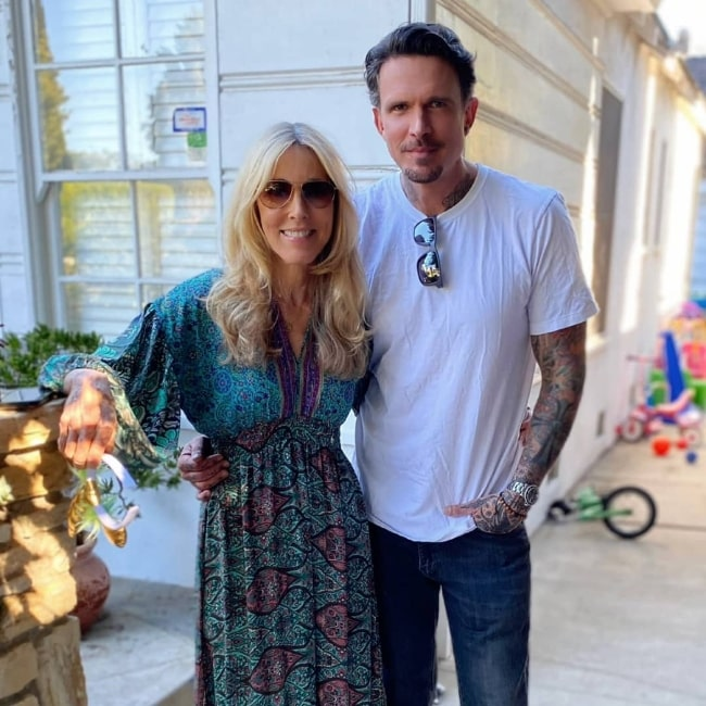 Alana Stewart posing for a picture alongside her son Ashley Hamilton at a birthday party for her granddaughter Willow in November 2020