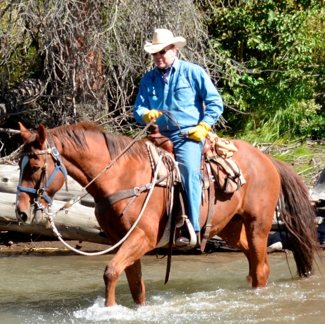 Albert II, Prince of Monaco as seen while riding through a river on a guided tour in the Shoshone National Forest in the United States in September 2013