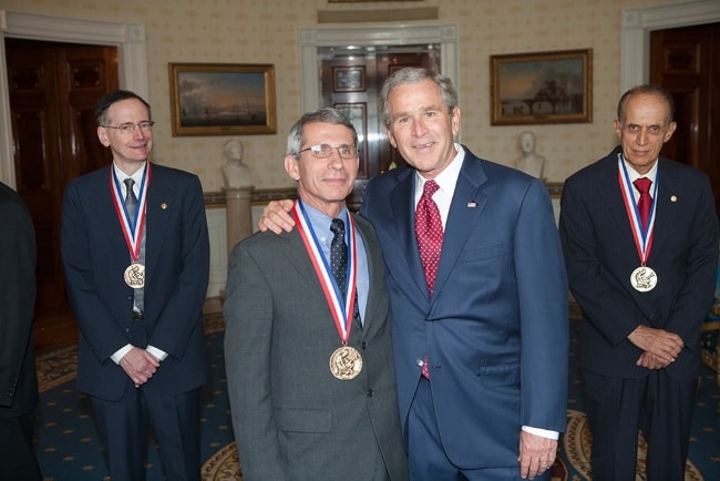 Anthony Fauci (Center Left) with President George W. Bush upon receiving the National Medal of Science in 2007. Also pictured are Dr. Tobin J. Marks (Corner Left) and Dr. Bradley Efron (Corner Right)