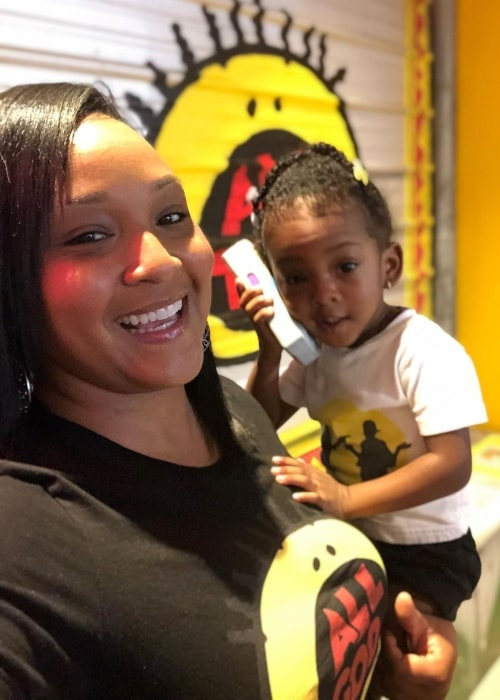 Asia Lee as seen in a selfie that was taken with her daughter Wisdom Mitchell at Good Burger pop-up in July 2019