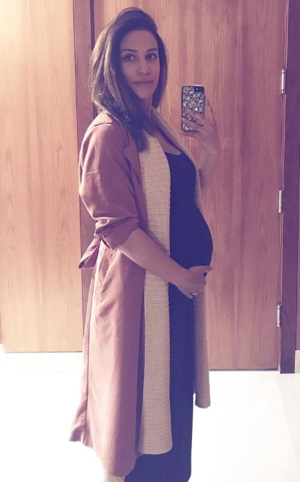 Christie Laing as seen while taking a mirror selfie showing her baby bump in May 2019