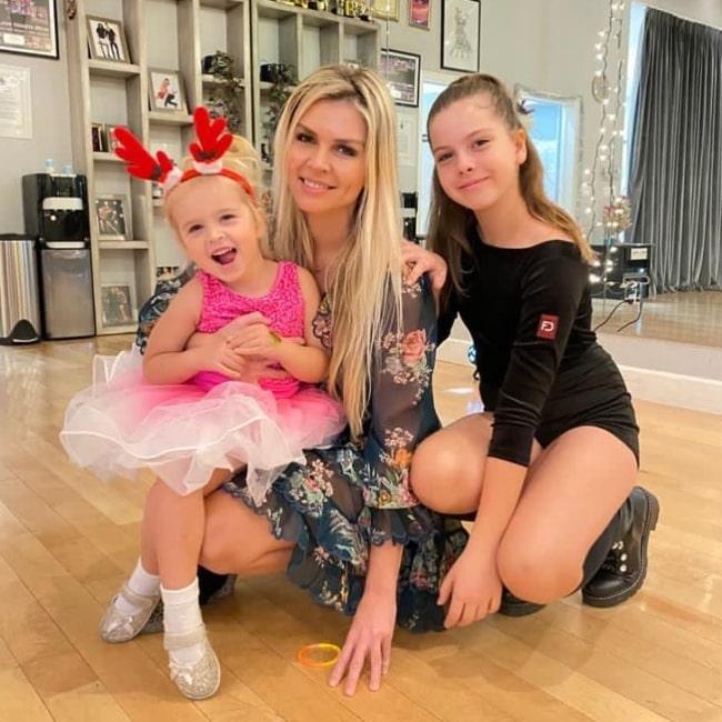 Elena Samodanova as seen in a picture that was taken with her daughters Zlata Savchenko and Olivia Savchenko in December 2020, Los Angeles, California