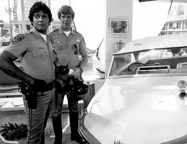 Erik Estrada (Left) as 'Ponch Poncherello' and Larry Wilcox as 'Jon Baker' from the television series 'CHiPS'