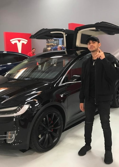 FaZe Rain as seen in a picture that was taken at a Tesla showroom in March 2017