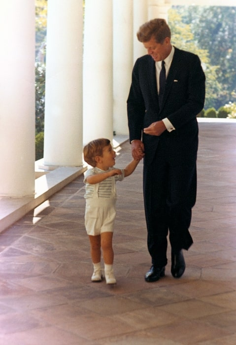 John F. Kennedy Jr. with his father John F. Kennedy at the White House in 1963