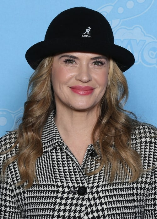 Kristy Swanson as seen while smiling for the camera at GalaxyCon Louisville in 2019