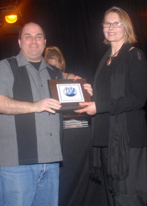 Maud Adams as seen presenting Jeffrey Howard with the award for Best TV Writing in 2008