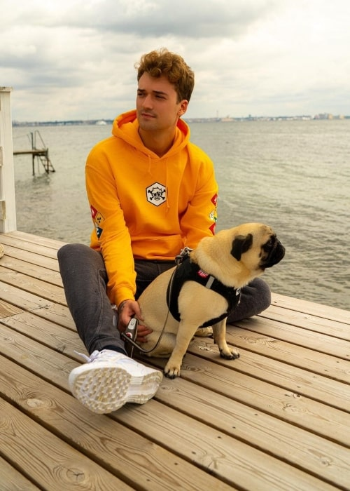 MrCrainer as seen in a picture that was taken with his dog Bobby in August 2019