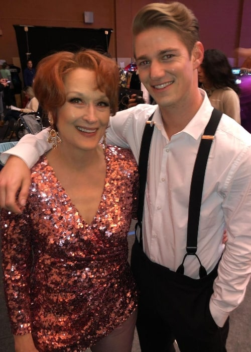Nico Greetham smiling for a picture alongside Meryl Streep at Paramount Studios in December 2020