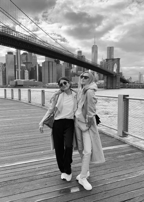 Phoebe Dynevor (Right) posing for a picture in New York City, New York