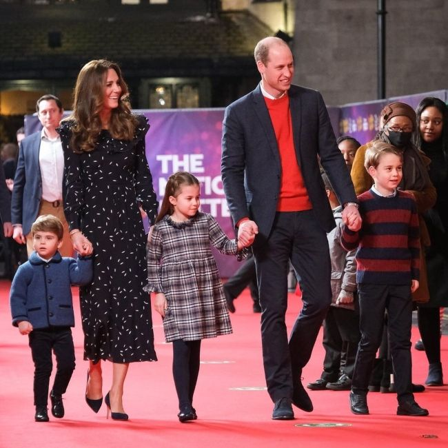 Prince Louis of Cambridge (left) as seen together with his family in December 2020