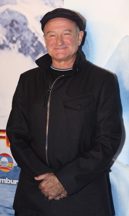 Robin Williams posing for the camera at the 'Happy Feet Two' Australian premiere at the Entertainment Quarter in Sydney, Australia in December 2011
